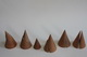 17 wooden cones with all types of conic sections